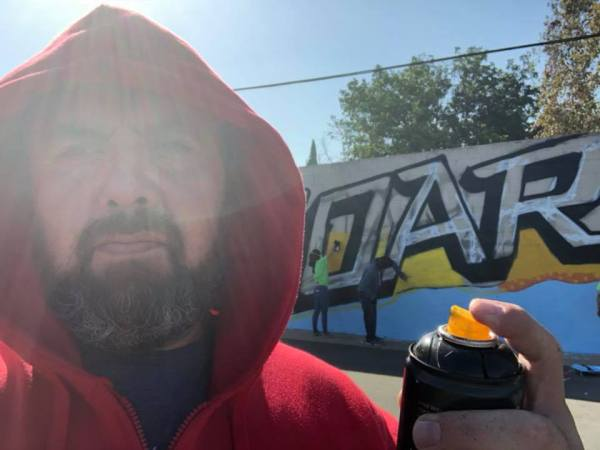 Hood Pastor involved in graffiti art